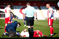 Luke Prosser of Stevenage is injured due to a jumping collision with Bradford City player Paudie O'Connor of Bradford City during the EFL Sky Bet League 2 match between Stevenage and Bradford City at the Lamex Stadium, Stevenage, England on 5 April 2021.