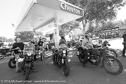 Gas stop during Stage 15 (244 miles) of the Motorcycle Cannonball Cross-Country Endurance Run, which on this day ran from Lewiston, Idaho to Yakima, WA, USA. Saturday, September 20, 2014.  Photography ©2014 Michael Lichter.