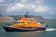 The Royal National Lifeboat Institution RNLI Dover Life boat 17-09 arriving into Folkestone Harbour, Folkestone, Kent. UK..