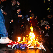 November 8, 2016 - New York, USA - Demonstrators lit an American flag on fire as nearly 7,500 protesters against the election of Donald Trump gathered to voice their discontent in Union Square followed by a march to Trump Tower in Manhattan on Wednesday, November 9, 2016.  Credit: Byron Smith (Credit Image: © Byron Smith/ZUMA Wire)