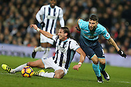 Borja Baston of Swansea city is challenged by Jonas Olsson of West Bromwich Albion. Premier league match, West Bromwich Albion v Swansea city at the Hawthorns stadium in West Bromwich, Midlands on Wednesday 14th December 2016. pic by Andrew Orchard, Andrew Orchard sports photography.