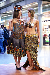 © Licensed to London News Pictures. 12/10/2015. London, UK. Models dressed in clothing made entirely from chocolate showcasing The Chocolate Show's fashion collection at St Pancras International station on Monday, 12 October, 2015. Photo credit: Tolga Akmen/LNP