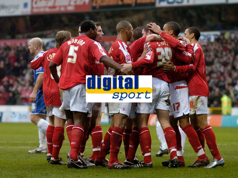 Photo: Glyn Thomas.<br />Nottingham Forest v Oldham Athletic. Coca Cola League 1.<br />14/01/2006.<br />Forest's Grant Holt is mobbed by his teammates after giving them a 1-0 lead on his debut for the club.