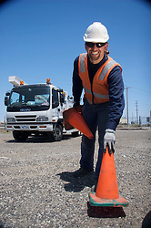 Worker with witches hats