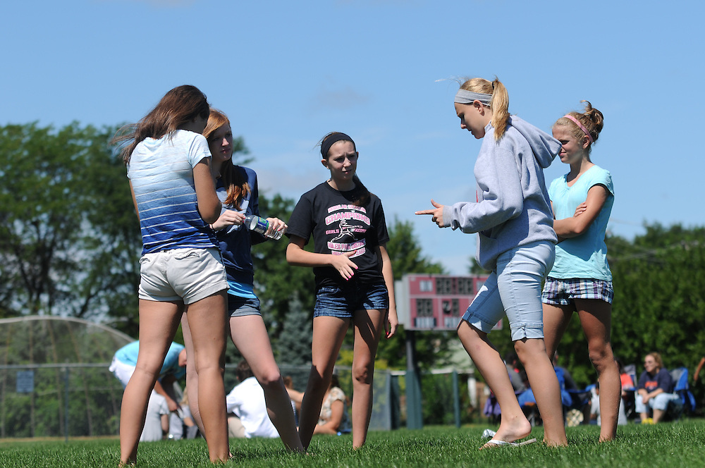 Resurrection High School students Molly Dougherty (L to R), Marikay Mesfer, Caitlin Ebervein, Jill Davis, and friend Maeve Dougherty chat on a soccer field during a back to school picnic celebrating the 90th anniversary of the all-girls College Prep school on Chicago's Northwest side on August 28, 2011 l Brian J. Morowczynski~ViaPhotos..For use in a single edition of Catholic New World Publications, Archdiocese of Chicago. Further use and/or distribution may be negotiated separately. ..Contact ViaPhotos at 708-602-0449 or email brian@viaphotos.com.   .