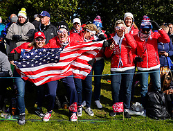 Auchterarder, Scotland, UK. 15 September 2019. Sunday Singles matches on final day  at 2019 Solheim Cup on Centenary Course at Gleneagles. Pictured; Enthusiastic Team USA fans with flag beside the 10th green. Iain Masterton/Alamy Live News