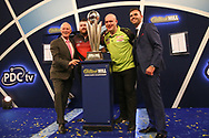 Barry Hearn with Michael Smith and Michael van Gerwen with the trophy during the 2019 William Hill World Darts Championship Final at Alexandra Palace, London, United Kingdom on 1 January 2019.