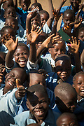 Happy school children waving and laughing, South Luangwa National Park, Zambia