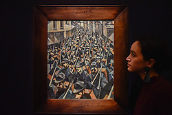 "© Licensed to London News Pictures. 17/11/2017. London, UK.  London, UK.  17 November 2017. A staff member views ""A Dawn"", 1914, by C.R.W. Nevinson (Est. GBP0.7-1.0m). Preview upcoming auctions of Modern & Post War British Art and Scottish Art taking place at Sotheby's, New Bond Street, on 21 and 22 November. Photo credit: Stephen Chung/LNP"