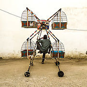 """12th March 2015, New Delhi, India. A '""""Jhula"""" wallah takes a break at the end of the day on the12th March 2015, New Delhi, India<br /> <br /> Manually powered merry-go-round's known as 'Jhulas' (Urdu, or 'Jhoolas') are a common sight in the colonies of India's capital. They are pushed around residential neighbourhoods and the operator, 'Jhula wallah' lifts the children into it and spins it by hand. <br /> <br /> PHOTOGRAPH BY AND COPYRIGHT OF SIMON DE TREY-WHITE, a photographer in Delhi<br /> + 91 98103 99809<br /> email: simon@simondetreywhite.com"""