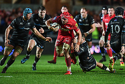 Scarlets' Josh Macleod is tackled by Ospreys' Rhys Webb - Mandatory by-line: Craig Thomas/Replay images - 26/12/2017 - RUGBY - Parc y Scarlets - Llanelli, Wales - Scarlets v Ospreys - Guinness Pro 14