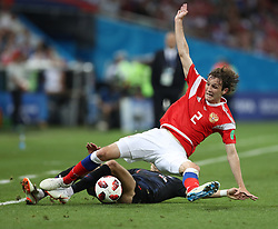 SOCHI, July 7, 2018  Mario Fernandes (top) of Russia vies with Ivan Perisic of Croatia during the 2018 FIFA World Cup quarter-final match between Russia and Croatia in Sochi, Russia, July 7, 2018. (Credit Image: © Xu Zijian/Xinhua via ZUMA Wire)