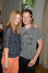 DOMINIC BROWN guitarist in Duran Duran and his wife MARTHA at an Evening with Notting Hill Guitars held at 167 Westbourne Grove, London W11 on 4th September 2013.