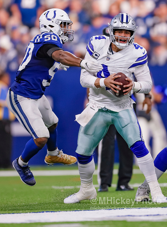 INDIANAPOLIS, IN - DECEMBER 16: Dak Prescott #4 of the Dallas Cowboys tries to escape the sack attempt by Anthony Walker #50 of the Indianapolis Colts during the game against the Indianapolis Colts at Lucas Oil Stadium on December 16, 2018 in Indianapolis, Indiana. (Photo by Michael Hickey/Getty Images) *** Local Caption *** Dak Prescott; Anthony Walker