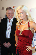 l to r: Hugh Hefner and Holly Madison at the Celebrity Catwalk co-sponsored by Alize held at The Highlands Club on August 28, 2008 in Los Angeles, California..Celebrity Catwork for Charity, a fashion show/lifestyle event, raises funds & awareness for National Animal Rescue.