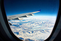 Southern Greenland from 36000 feet. Image taken with a Nikon 1 V2 camera and 10 mm f/2.8 lens and Olympus FCON-T01 fisheye adapter (ISO 200, 7.5 mm, f/11, 1/640 sec).