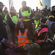 Thousands of Extinction Rebellion activists took over 5 bridges in Central London and blocked them for the day, November 17 2018, Central London, United Kingdom. Lambeth Bridge; a group of Rebel Army Clowns in action. Around 11am people on all bridges sat down in the road and blocked traffic from coming through and stayed till late afternoon. The actvists believe that the government is not doing enough to avoid catastrophic climate change and they demand the government take radical action to save future generations and the planet. Many are willing to be arrested peacefully protesting and up to 80 were arrested on the day. Extinction Rebellion is a grass root climate change group started in 2018 and has gained a huge following of people commited to peaceful protests and who ready to be arrested. Their major concern is that the world is facing catastropohic climate change and they want the British government to act now to save future generations.