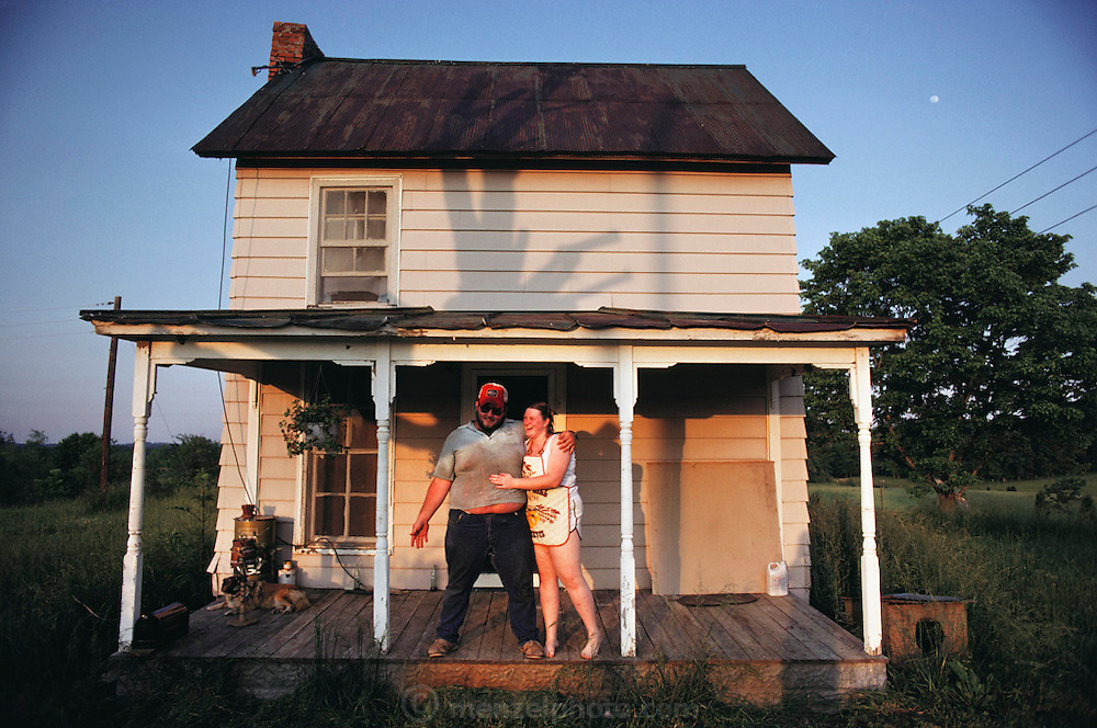 Darel Walton and his new bride on the porch of their rented rural house near Charlotte, Tennessee. MODEL RELEASED.