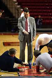 03 February 2007:  Director of Athletics,  Dr. Sheahon Zenger directs the facilities crew in last minute preparations on the Doug Collins Court insignia. In what is locally referred to as the War on Seventy Four, the Bradley Braves defeated the Illinois State University Redbirds 70-62 on Doug Collins Court inside Redbird Arena in Normal Illinois.
