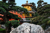 The Pavilion of Absolute Perfection at Nan Lian Garden, Hong Kong -  The Pavilion of Absolute Perfection is situated in the middle of Lotus Pond and an octagonal golden colored structure - it is connected to the mainland by the Zi Bridge and the Wu Bridge.Nan Lian Garden is connected to Chi Lin Nunnery.  Although this Chinese garden is fairly new, it exudes a timeless ambiance, despite the fact that it was designed in 2003 and completed in 2006. Both the garden and the nunnery are build in the Tang Dynasty style.  The style of this special garden, was modeled after Jiangshouju Garden in Shanxi, China.  It is made up of springs, rockeries, waterfalls, ponds, pavilions bridges and winding paths.  The garden and nunnery are considered a public park of Hong Kong and are consequently free to enter, with the exception of the fancy teahouse on the pond that.  Everywhere else is unrestricted, except certain paths leading to Pavilion Bridge or Pavilion of Absolute Perfection. <br /> Nan Lian Garden is situation just below the Lotus Pond Garden of Chi Lin Nunnery to which it is connected. The focal point of the Lotus Pond Garden is of course its pond and the lotuses blooming within, as well as reflections of the temple and nunnery in the background.  Nan Lian Garden and Chi Lin Nunnery were promoted by the Hong Kong and Chinese Governments to UNESCO, and are presently on the tentative UNESCO World Heritage list.
