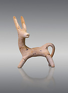Early Cretian Minoan goat shaped clay vessel, 2300-1900 BC,  Heraklion Archaeological  Museum cat no 5114, grey background. .<br /> <br /> If you prefer to buy from our ALAMY PHOTO LIBRARY  Collection visit : https://www.alamy.com/portfolio/paul-williams-funkystock/minoan-art-artefacts.html . Type -   Heraklion   - into the LOWER SEARCH WITHIN GALLERY box. Refine search by adding background colour, place, museum etc<br /> <br /> Visit our MINOAN ART PHOTO COLLECTIONS for more photos to download  as wall art prints https://funkystock.photoshelter.com/gallery-collection/Ancient-Minoans-Art-Artefacts-Antiquities-Historic-Places-Pictures-Images-of/C0000ricT2SU_M9w
