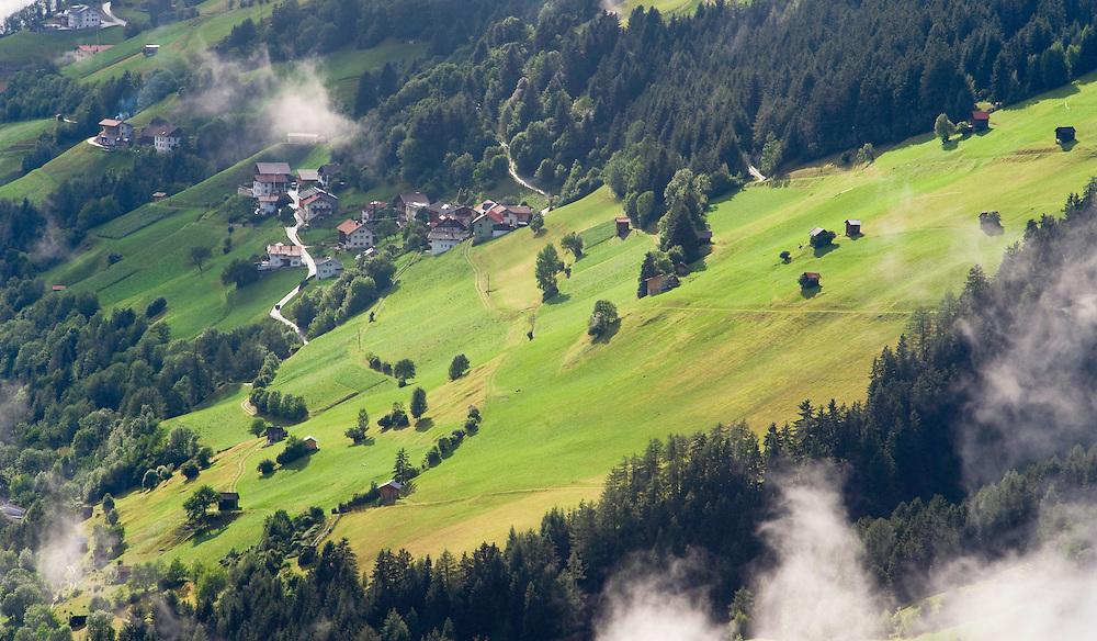 IFTE-NB-007648; Niall Benvie; View into the valley around Fliess from Kaunergrat visitor's centre; Austria; Europe; Tirol; horizontal; green; meadow forest woodland; 2008; July; summer; fog mist rain cloud; Wild Wonders of Europe Naturpark Kaunergrat
