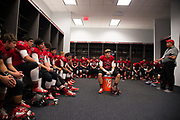 The Iraan High School football team listen to coach Mark Kirchhoff before the state championship game at AT&T Stadium in Arlington, Texas on December 15, 2016. (Cooper Neill for The New York Times)