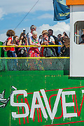 Vivienne Westwood visits the Greenpeace area which includes a huge mock uo of the Arctic Sunrise, an exhibition of images aof the imprisoned Arctic 30 and a giant animatronic polar bear - all aimed at 'Saving the Arctic'. The 2014 Glastonbury Festival, Worthy Farm, Glastonbury. 27 June 2013.