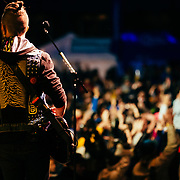 Micahel Franti and Spearhead perform to a packed crowd in Teton Village, Wyoming. Guitarist J Bowman solos during concert.