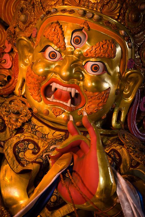 Statue of a wrathful Buddhist deity, Gandan Monastery, Ulaanbaatar, Mongolia. Photo © Robert van Sluis