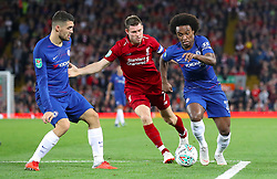 Chelsea's Willian (right) and Liverpool's James Milner battle for the ball during the Carabao Cup, Third Round match at Anfield, Liverpool.