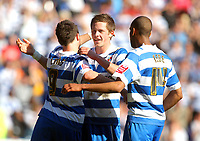 Photo: Andrew Fosker/Richard Lane Photography. Reading v Peterborough United. Coca Cola Championship. 17/04/2010. Goal Scorers: Shane Long (L) , Gylfi Sigurdsson (centre) and Jimmy Kebe (R) celebrate Sigurdsson's second goal and Reading's 6th during a 6-0 victory over relegated Peterborough