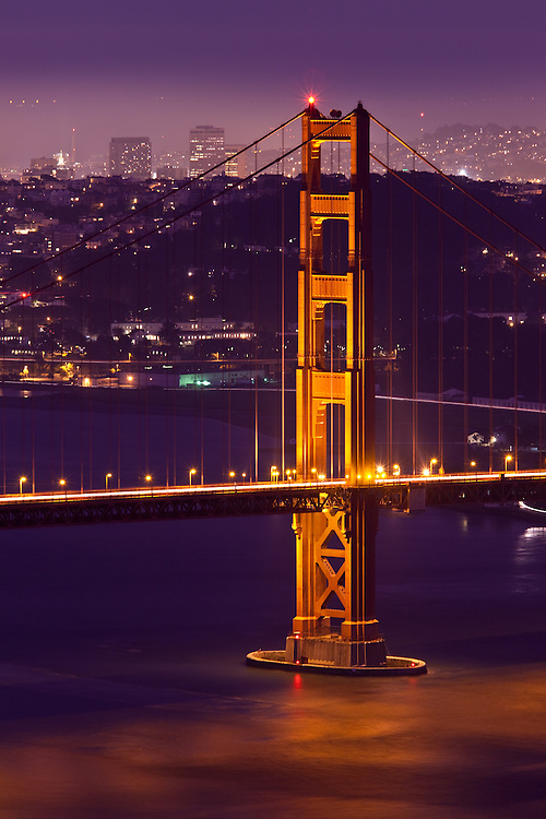 san francisco view at night from marin headlands, closeup view of tower on the golden gate bridge