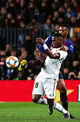 BARCELONA, Feb. 7, 2019  Real Madrid's Vinicius Junior (bottom) competes with FC Barcelona's Nelson Semedo during the Spanish King's Cup semifinal first leg match between FC Barcelona and Real Madrid in Barcelona, Spain, on Feb. 6, 2019. The match ended with a 1-1 draw. (Credit Image: © Joan Gosa/Xinhua via ZUMA Wire)