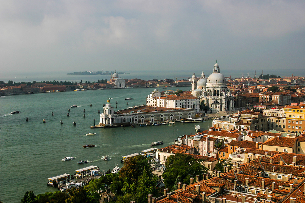 The monumental church of Santa Maria della Salute towers up right at the beginning of the Canal Grande in Venice, Italy. Truly magnificent both on the interior and on the exterior, theatre church has a splendid cupola and a spectacular central nave with an octagonal layout.