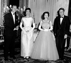 File photo dated 05/06/1961 of (left to right) the Duke of Edinburgh, the then First Lady Jacqueline Kennedy, Queen Elizabeth II and the then US President John F Kennedy at Buckingham Palace, London.