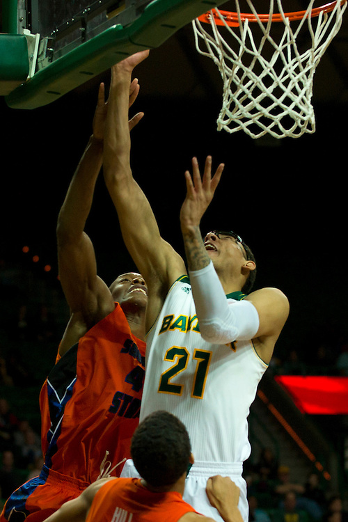WACO, TX - JANUARY 3: Isaiah Austin #21 of the Baylor Bears drives to the basket against the Savannah State Tigers on January 3, 2014 at the Ferrell Center in Waco, Texas.  (Photo by Cooper Neill) *** Local Caption *** Isaiah Austin