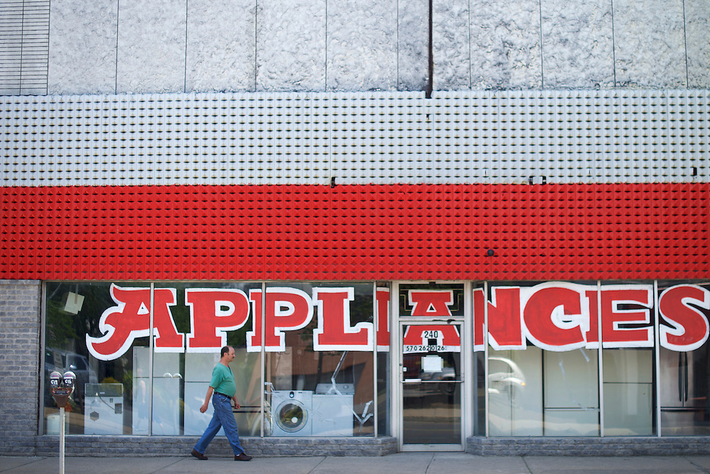 WILKES-BARRE- May 26, 2016.  A man walks past a shuttered appliances store in Wilkes-Barre, PA, a city of 41,000 in central Pennsylvania.  Wilkes-Barre is the county seat of Luzerne County, in which 77.4% of Republicans voted for Donald Trump.