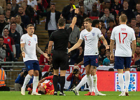 Football - 2018 / 2019 UEFA Nations League A - Group Four: England vs. Spain<br /> <br /> John Stones (England) and Kieran Trippier (England) protest to the Referee Danny Makkelie (NED) as the England player receives a yellow card at Wembley Stadium.<br /> <br /> COLORSPORT/DANIEL BEARHAM
