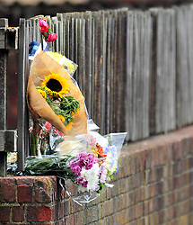 © Licensed to London News Pictures. 08/08/2018<br /> Deptford, UK. Flowers left outside a property where 7 year Joel Urhie was killed in a suspicious house fire at Adolphus Street, Deptford.  <br /> Photo credit: Grant Falvey/LNP