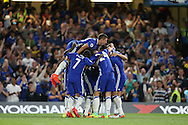 Eden Hazard of Chelsea celebrates with his teammates after scoring his sides 1st goal to make it 1-0 from a penalty. Premier league match, Chelsea v West Ham United at Stamford Bridge in London on Monday 15th August 2016.<br /> pic by John Patrick Fletcher, Andrew Orchard sports photography.