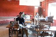 India working in a sewing workshop