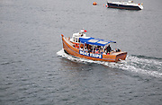 Small boat offering trips in the harbour, Oban, Argyll and Bute, Scotland, UK