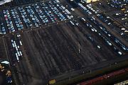 Nederland, Utrecht, Leusden, 10-01-2011;.Parkeerterrein en gebouwen van PON automobielbedrijf bedrijven, importeur vano.a.  Volkswagen (VW), Audi, Seat, Skoda, Porsche. Het parkeerterrein is niet helemaal gevuld, nieuwe autoverkoop is teruggelopen door de financiele crisis...luchtfoto (toeslag), aerial photo (additional fee required).foto/photo Siebe Swart