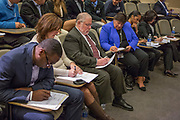 Purchase, NY – 31 October 2014. Judges making notes after a presentation. The Business Skills Olympics was founded by the African American Men of Westchester, is sponsored and facilitated by Morgan Stanley, and is open to high school teams in Westchester County.