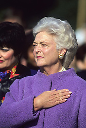 Former first lady Barbara Bush, wife of former President George H.W. Bush and mother of former President George W. Bush, died Tuesday at her home in Houston. She was 92. Barbara Bush had been in failing health, suffering from congestive heart failure and chronic obstructive pulmonary disease. George and Barbara, who celebrated their 73rd wedding anniversary on Jan. 6, hold the record for the longest-married presidential pair. Mrs. Bush was known for her wit and emphasis on family. One of her primary causes was literacy. She founded the Barbara Bush Foundation for Family Literacy in 1989 to carry forth her legacy in the cause for literacy. PICTURED: 1990 - Washington, District of Columbia, United States of America - First Lady BARBARA BUSH holds her hand over her heart as the American Athem is played at the White House during official State visit ceremony on the South Lawn. (Credit Image: © Mark Reinstein via ZUMA Wire)