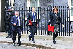 © Licensed to London News Pictures. 22/10/2019. London, UK. Justice Secretary ROBERT BUCKLAND QC (R), Secretary of State for Health and Social Care MATT HANCOCK (C) and Secretary of State for Digital, Culture, Media and Sport NICKY MORGAN departs from No 10 Downing Street to attend the weekly cabinet meeting. Photo credit: Dinendra Haria/LNP