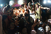 MANCHESTER, TN - JUNE 12: DJ Girl Talk performs as concert goers rush the stage to dance at the 2009 Bonnaroo Music and Arts Festival on June 12, 2009 in Manchester, Tennessee. Photo by Bryan Rinnert/3Sight Photography