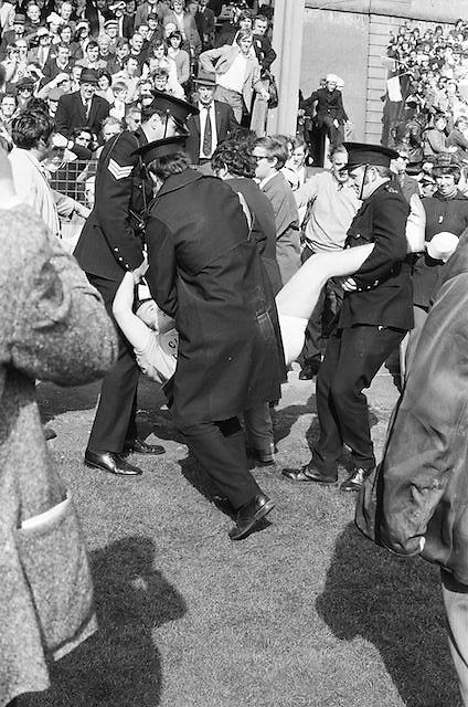 A supporter is removed from the pitch by security during the All Ireland Senior Gaelic Football Championship Final Dublin V Galway at Croke Park on the 22nd September 1974. Dublin 0-14 Galway 1-06.