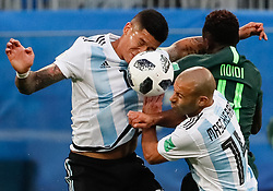 June 26, 2018 - Saint Petersburg, Russia - Onyinye Ndidi of Nigeria national team vies for a header with Marcos Rojo (L) and Javier Mascherano of Argentina national team during the 2018 FIFA World Cup Russia group D match between Nigeria and Argentina on June 26, 2018 at Saint Petersburg Stadium in Saint Petersburg, Russia. (Credit Image: © Mike Kireev/NurPhoto via ZUMA Press)